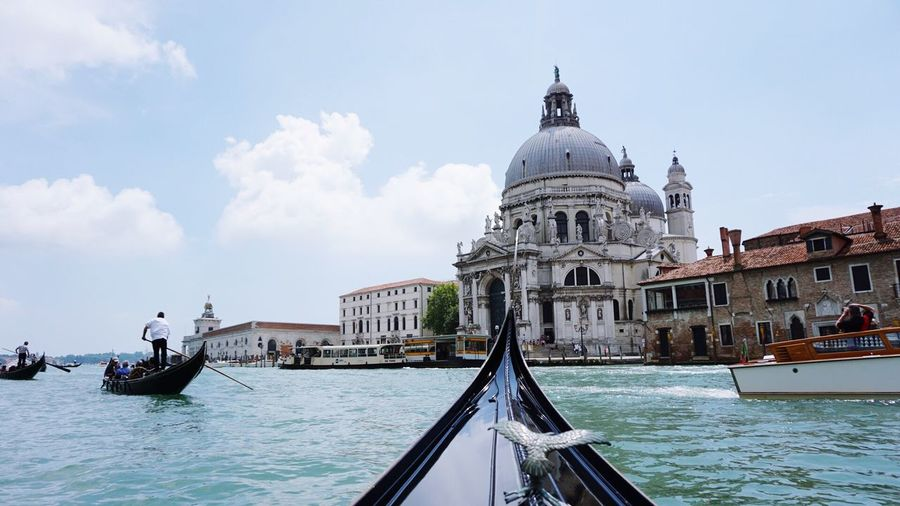 People on gondolas sailing in grand canal by santa maria della salute