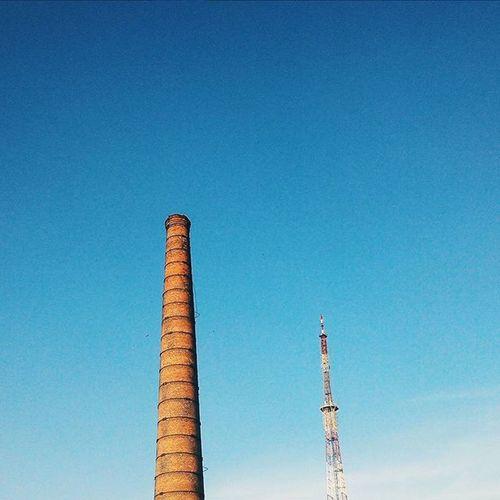 такие разные, но так похожи 🗼 Sky Blue Foreshortening Vscocam Vscofollow Colors Instagomel Gomel Tower Contrast