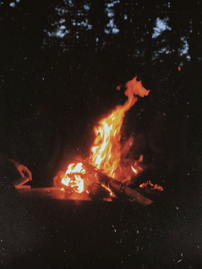 Close-up of fire in water at night