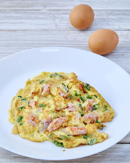 Omelet with brown eggs on table