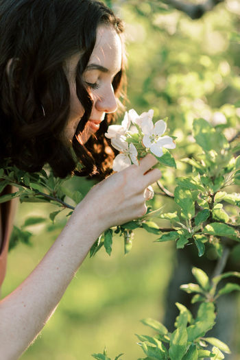Woman holding flowering plant