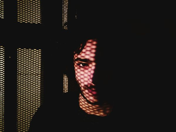 Portrait of Luca. One Person Man Headshot Indoors  Adult Portrait People City Architectural Detail Light And Shadow Highcontrast HighContrastPhotography Streetphotography Eye Silouette And Shadows Yellow Color