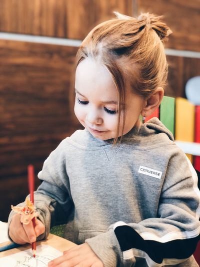 Girl EyeEm Selects Childhood Child Girls Real People Females EyeEmNewHere Leisure Activity Indoors  Holding Women Cute Sitting Offspring One Person Playing Innocence Casual Clothing Lifestyles