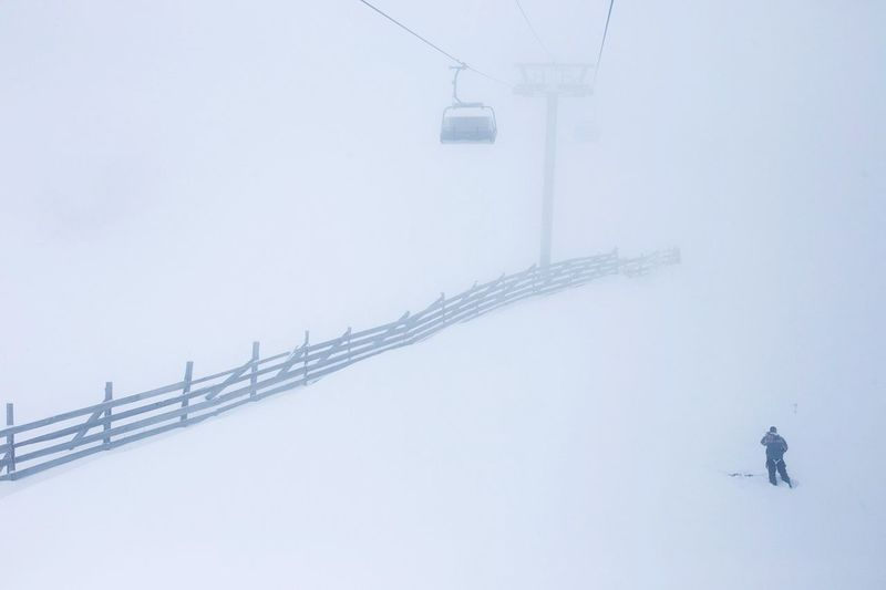 Winter Cold Temperature Snow Clear Sky Outdoors Day Nature Real People Overhead Cable Car Beauty In Nature Sky Snowing