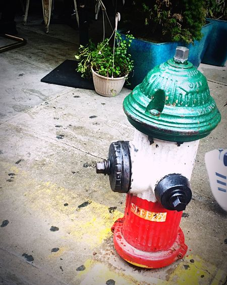 High angle view of fire hydrant on footpath in city