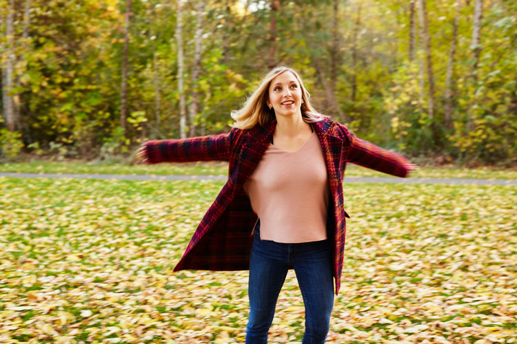 Adult Adults Only Autumn Beautiful Woman Carefree Carrying Casual Clothing Cheerful Day Enjoyment Focus On Foreground Front View Happiness Jeans Long Hair One Person One Woman Only One Young Woman Only Only Women Outdoors People Smiling Standing Walking Young Adult