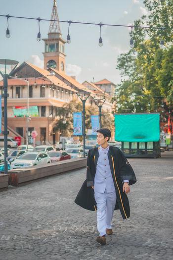 Woman walking on street in city