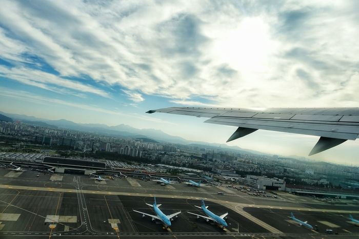 Korea Photos Runway TakeOff Airplane Airport Aerial Shot Landscape Cloudpark Clouds And Sky Light And Shadow From An Airplane Window