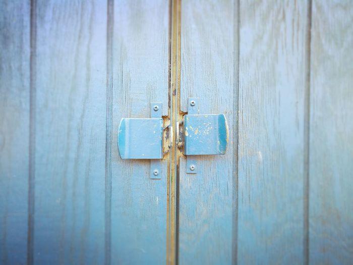 Unlocked Unlockedwithnokey Unlocked Latch Wood - Material Door Protection Metal Close-up Architecture Closed Door Closed