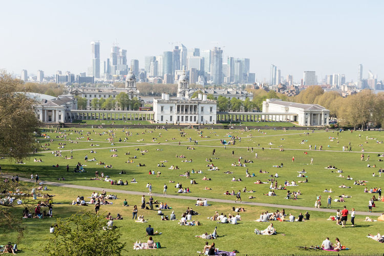 Greenwich British Culture Architecture Building Exterior Crowd Built Structure Large Group Of People Real People Group Of People City Grass Sky Plant Day Nature Landscape Building Travel Destinations Men Tree Leisure Activity Cityscape Outdoors Office Building Exterior Skyscraper My Best Photo Springtime Decadence The Great Outdoors - 2019 EyeEm Awards