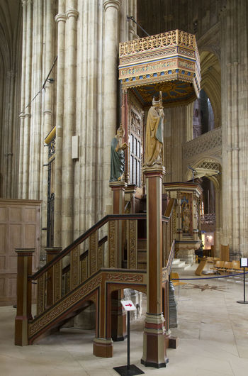 Architectural Column Architectural Feature Architecture Building Built Structure Cathedral Column Day Empty Gothic Gothic Architecture Historic No People Ornate Pulpit Pew Columns Pillars Wood Structure Wood Sculpture Carving Church Decoration Religion Canterbury Cathedral
