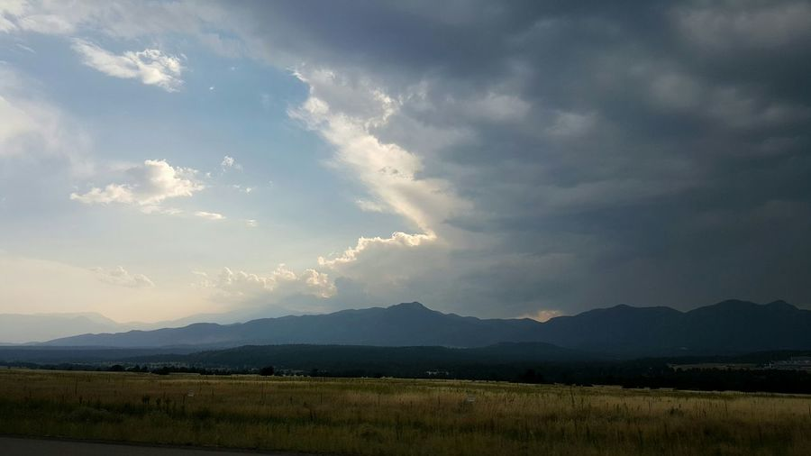 The Smoke from the wildfires out west are combining with some wicked dark Storm Clouds Storm Stormy Weather Landscape Mountains