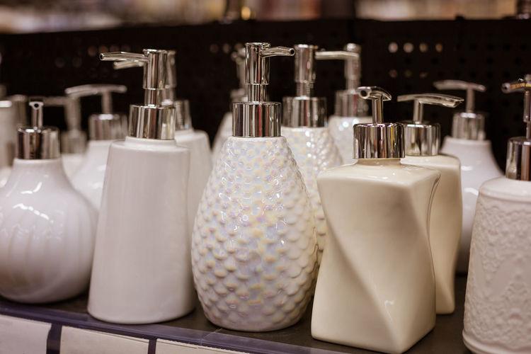Glass liquid soap dispenser on a shelf in a store