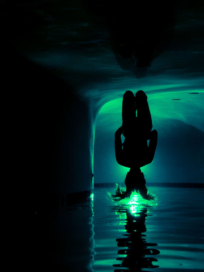 Full length of silhouette person swimming in pool