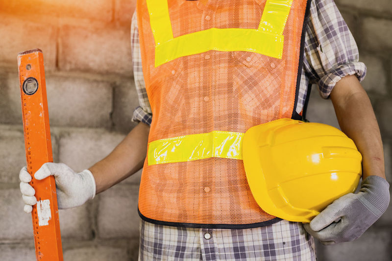 Midsection of man working at construction site