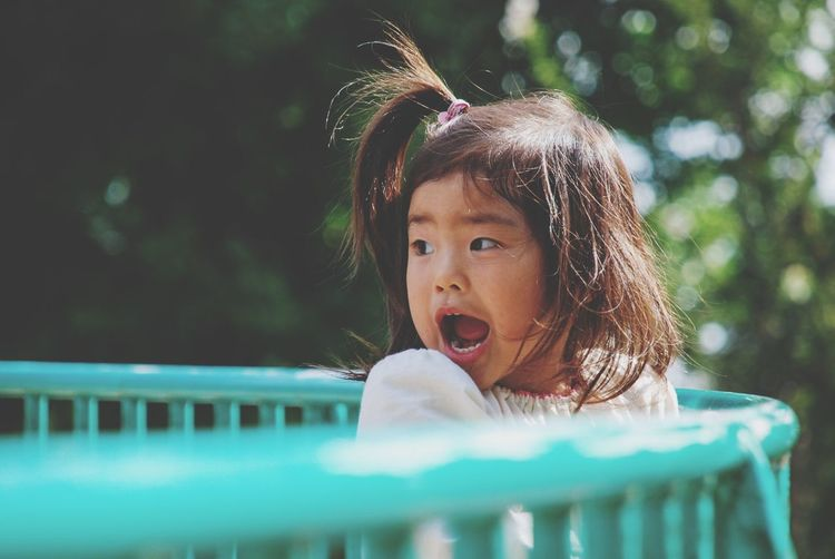 Girl Screaming While Playing In Park