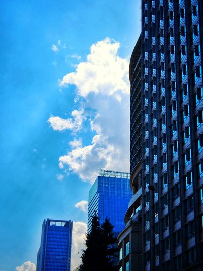 cloud among the buildings Clouds And Sky Buildings Fujifilm XQ1 Walking Around at Ootemachi in Tokyo Japan