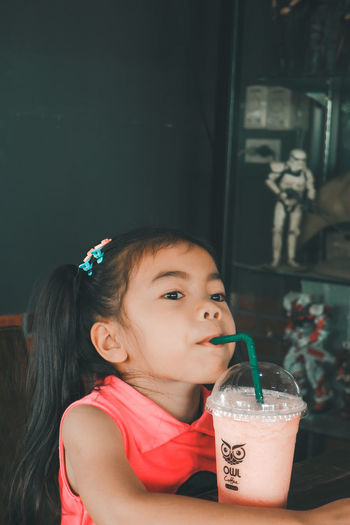 Girl drinking coffee in cafe