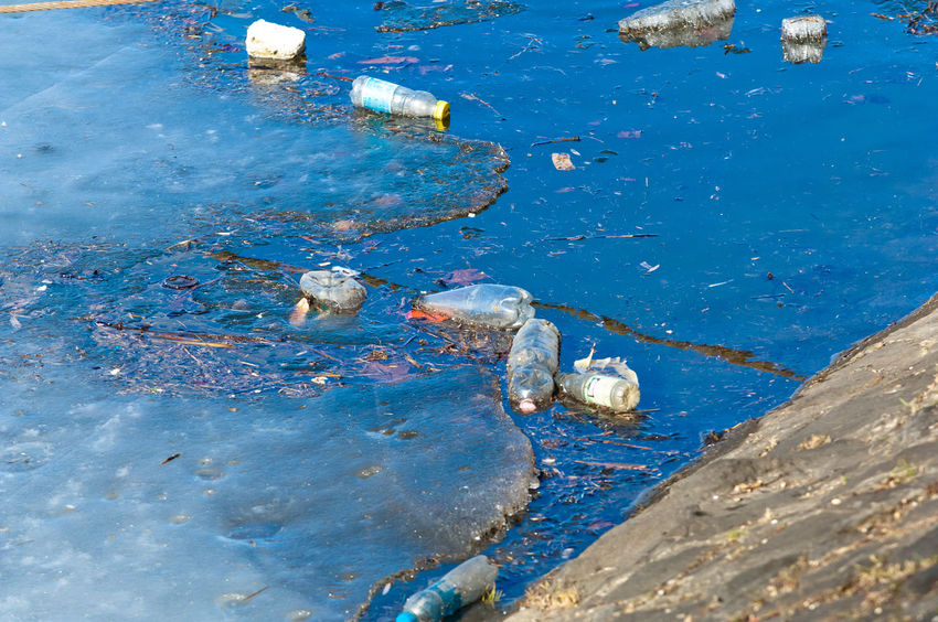 Waste floating on polluted river surface Bottles Enviromental Issue Floating Garbage Plastic Poison Polluted Pollution Pollution In My World River Trash Waste Water
