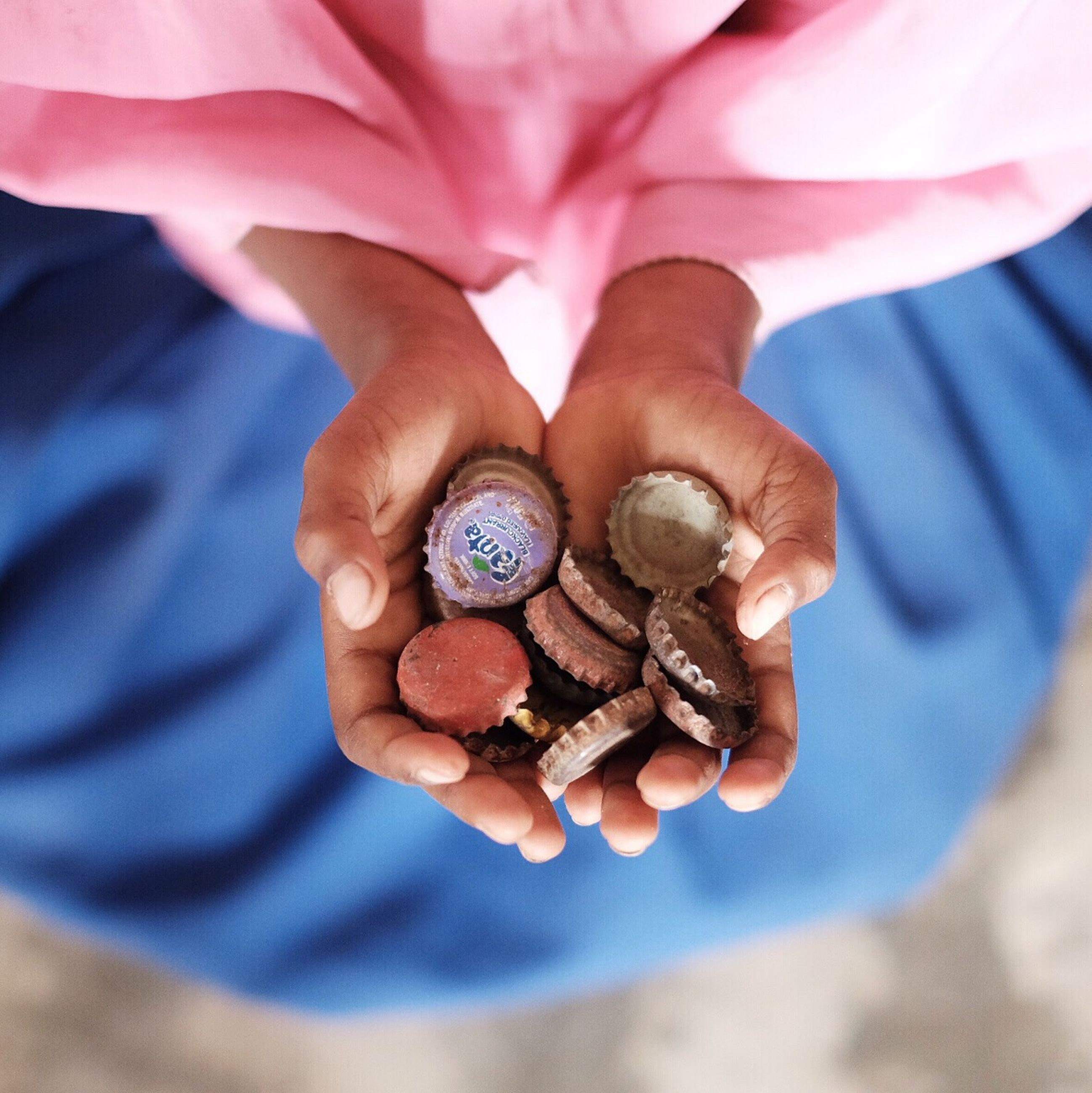person, food and drink, freshness, close-up, holding, food, part of, human finger, focus on foreground, cropped, unrecognizable person, selective focus, fruit, healthy eating, high angle view, seashell, day