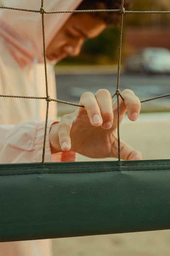 Midsection of boy holding net outdoors