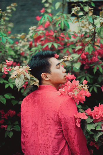 Man and red flowering plants