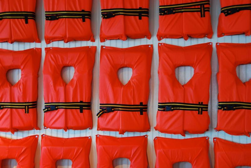Backgrounds Day Empty Life Preserver Life Vest Locker Room No People Orange Outdoors Red Repetition