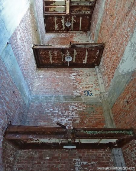 Where the stairs used to be. www.placesthatwere.com Abandoned Places Rust Belt Abandoned Buildings Creepy Abandoned & Derelict Factory Building Abandoned Urbex Abandoned Ohio Abandoned Building Abandoned Factory Urban Exploration Stairwell Lighting Light Bulbs Landings Landing Eerie Decay Brick Building Architecture Brick Brick Wall