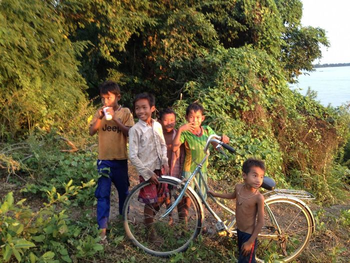 EyeEm Gallery Friends Happy Mekong River Travel Travel Photography Bicycle Boy Boys Casual Clothing Child Childhood Day Full Length Group Of People Leisure Activity Nature Outdoors People People Photography Smiling Standing Togetherness Transportation Tree Human Connection Moments Of Happiness
