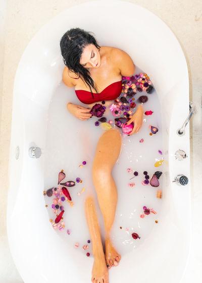 High angle view of beautiful woman in bathtub
