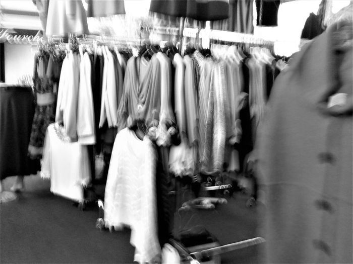 Boutique Business Finance And Industry Choice Close-up Clothes Rack Clothing Clothing Store Coathanger Day Fashion For Sale Hanging In A Row Indoors  Large Group Of Objects No People Retail  Small Business Store Variation