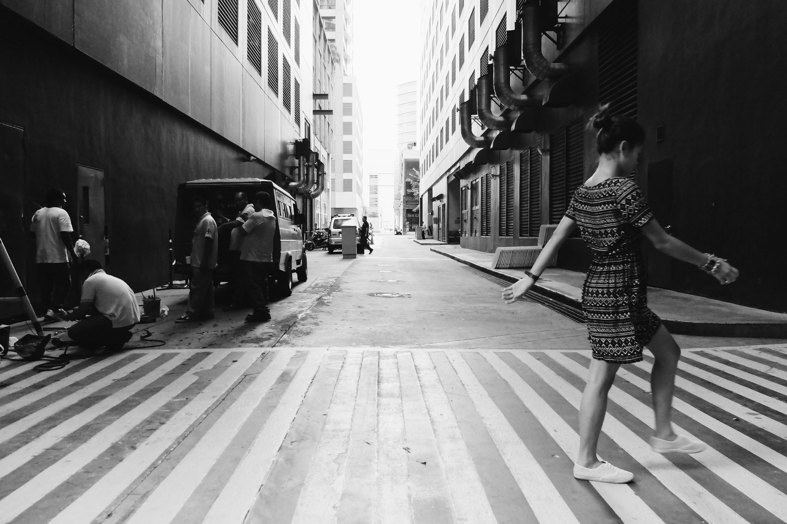 architecture, building exterior, built structure, the way forward, city, street, incidental people, person, men, sunlight, walking, city life, diminishing perspective, lifestyles, day, shadow, clear sky, in a row