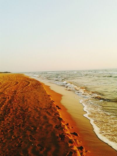 Greece, peloponnisos Beach Sea Sand Horizon Over Water Scenics Tranquil Scene Water Shore Clear Sky Tranquility Copy Space Beauty In Nature Wave Coastline Nature Non-urban Scene Tide Travel Destinations Seascape Outdoors