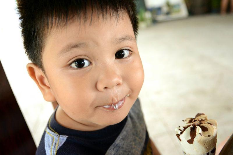 Close-Up Portrait Of Boy Having Ice Cream