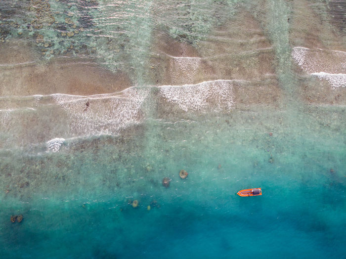 Aerial view of boat moored on sea