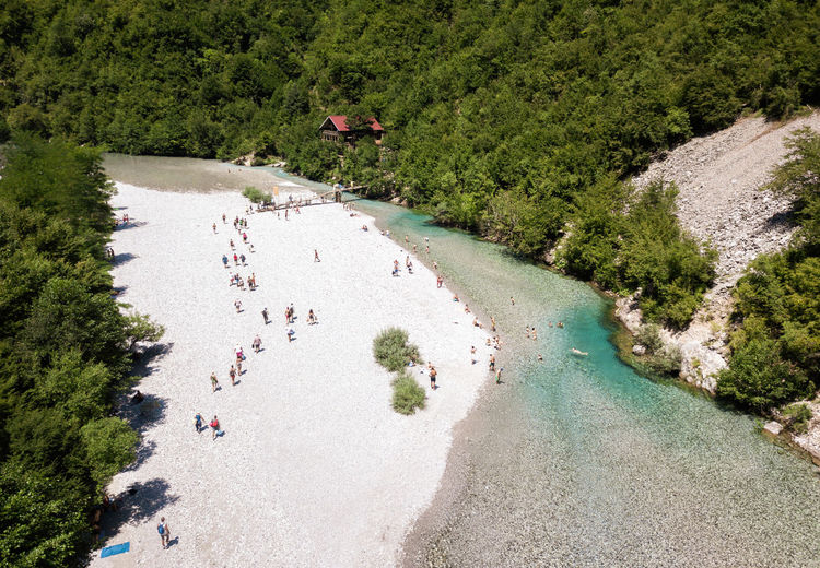 High angle view of people on river amidst trees