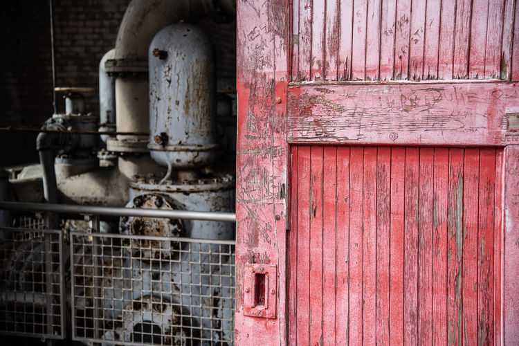 Sliding Door Pump House Pump Red Pipe - Tube Building Exterior Machinery Built Structure Abandoned Architecture Industry Outdoors Close-up Day Rusty Metal Old No People Riverfront Park Columbia Sc