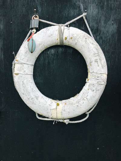 Lifebuoy ring hanging on wooden wall