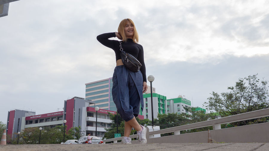 Sky One Person Lifestyles Cloud - Sky Day Nature Front View Beautiful Woman Young Adult Young Women Low Angle View
