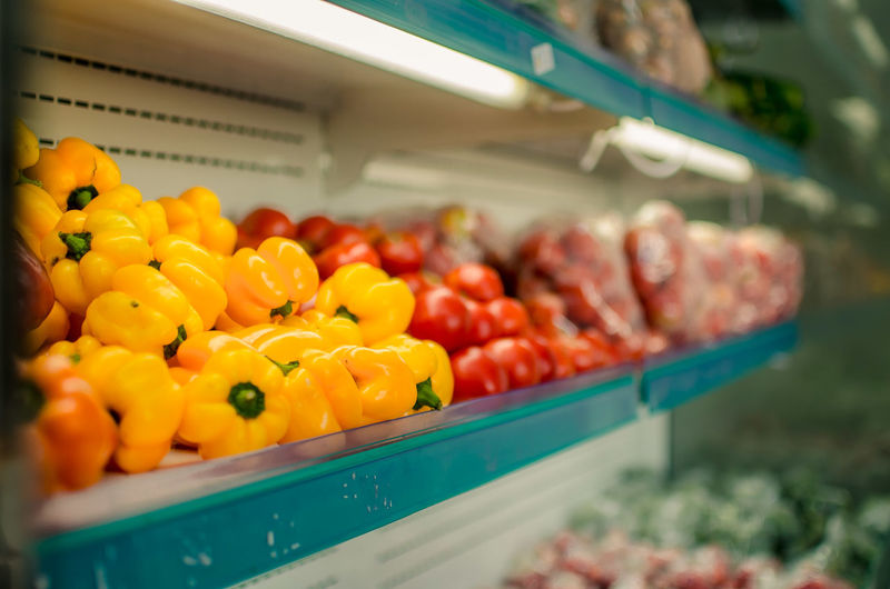 Yellow Bell Peppers On Shelf For Sale At Store