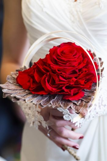 Bride holding a heart-shaped bouquet Lifestyles Nikon Nikonphotography Capture Tomorrow Streetphotography Women Portrait Nikonphotographer Colors Flowers Light Work Bride Flower Red Wedding Dress Flower Head Ceremony Bouquet Wedding Rose - Flower Females Wedding Ceremony Wedding Vows