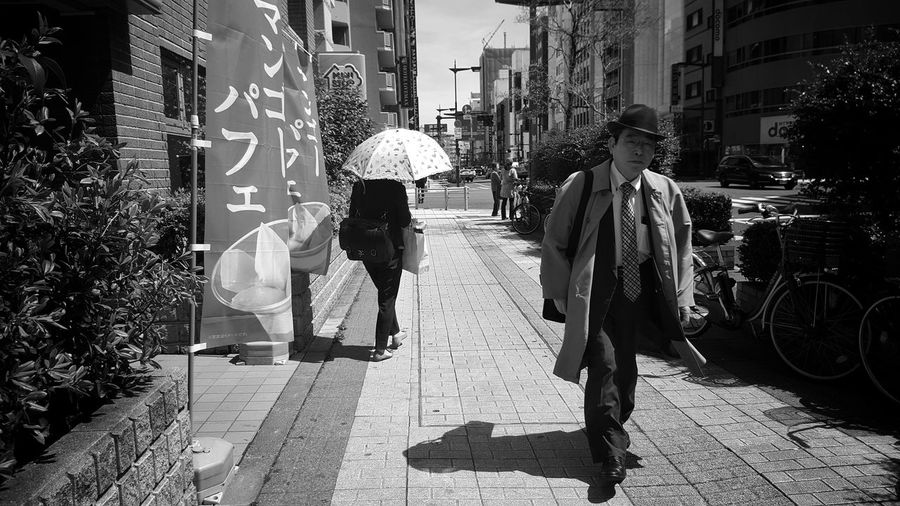 Walking Street Lifestyles City Full Length Men Women Two People Real People Outdoors Day Tokyo Japan City Life Streetphotography Streetphoto_bw Street Photography City Cityscape People Commuter Passenger Journey Bakurocho EyeEm Diversity The Street Photographer - 2017 EyeEm Awards
