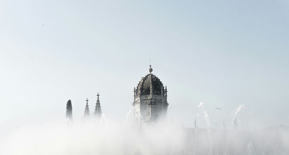 High Section Of Mosteiro Dos Jeronimos Against Sky During Foggy Weather