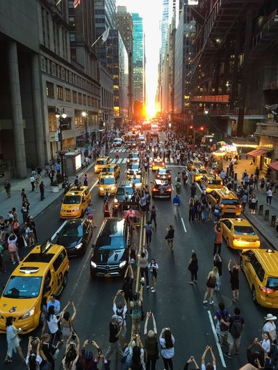 Manhattan Henge Sunset_collection Sunset Manhattanhenge City Street Large Group Of People City Life Crowd Traffic High Angle View Taxi