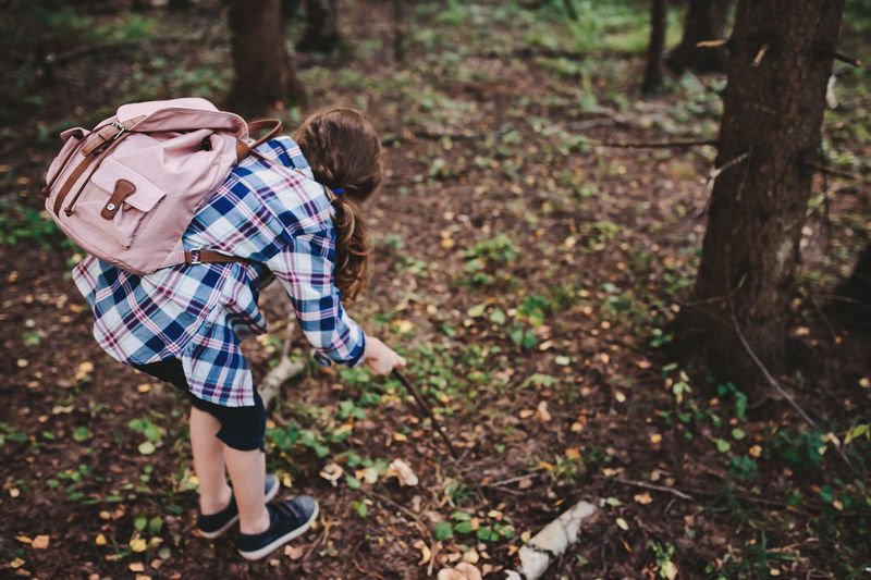 happy kid girl exploring summer forest, traveling on vacation. Teaching kids to love nature. Earth day concept. Plant Real People Nature Lifestyles Outdoors Summer Summertime Woods Forest WoodLand Explore Adventure Travel Wild Backpack Kid Childhood Girl Happy Authentic Moments