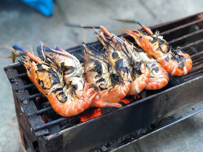 EyeEm Selects Seafood Healthy Eating Food Food And Drink Wellbeing High Angle View For Sale Vertebrate Focus On Foreground Still Life Raw Food Close-up Barbecue Fish Animal Orange Color Crustacean Freshness No People Lobster