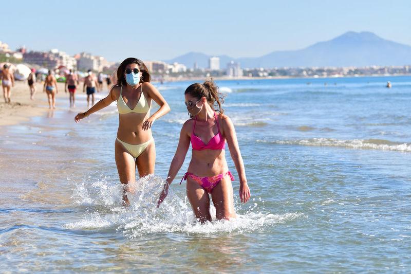 Women walking on beach