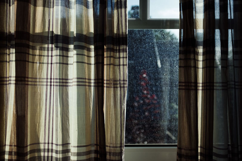 Close-Up Of Curtain Hanging On Window At Home