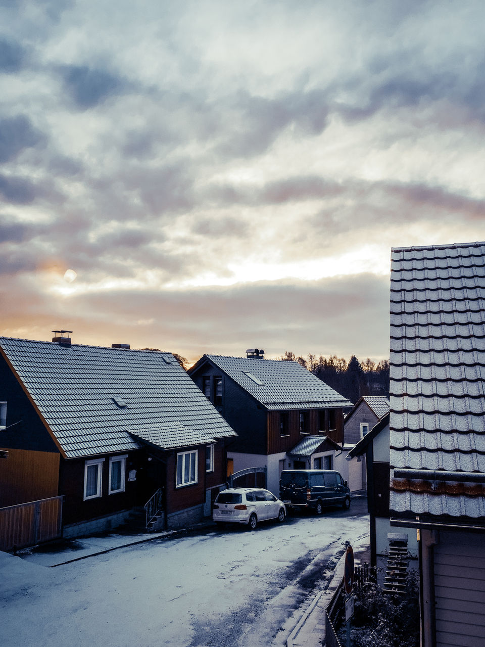 architecture, built structure, building exterior, cloud - sky, building, sky, city, residential district, roof, house, nature, winter, no people, snow, cold temperature, outdoors, day, office building exterior, sunset, skyscraper