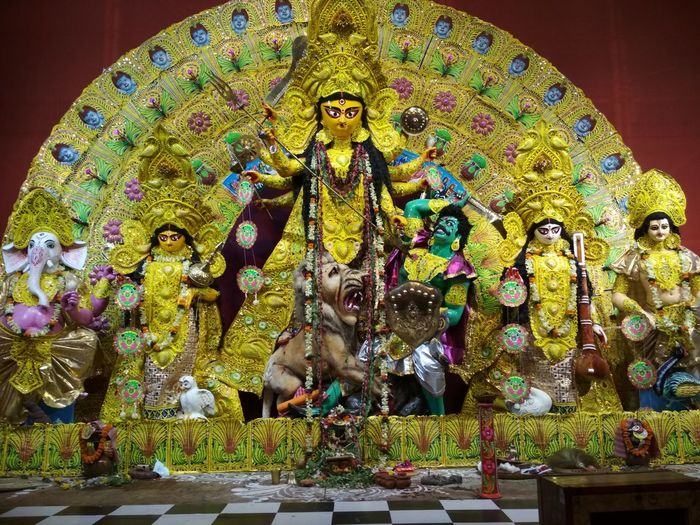 Idols of Devi Durga and her childrenOf Devi Durga And Her Children Religion Art And Craft Spirituality Multi Colored Statue Sculpture No People Day Elephant Indoors
